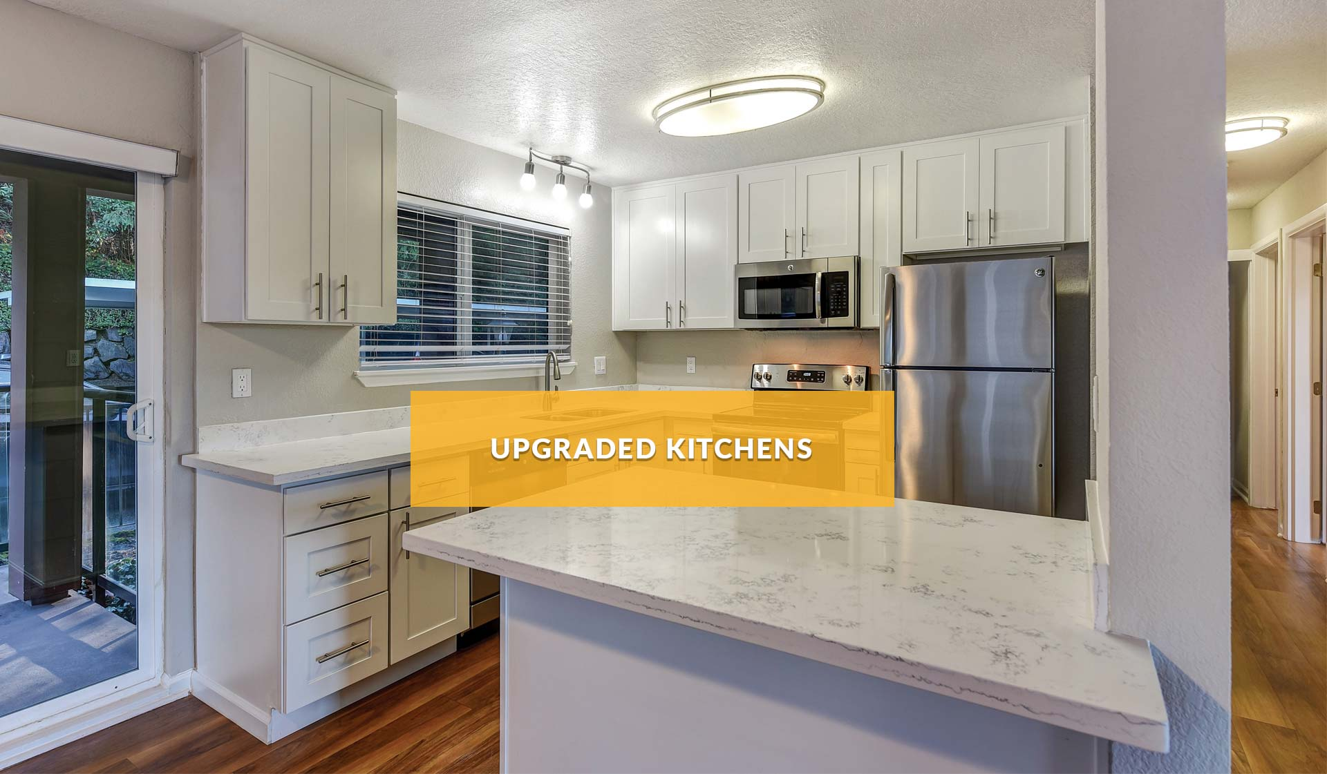 Cedar Rim Apartments - modern kitchen with with cabinets and marbled countertops - newcastle, washington