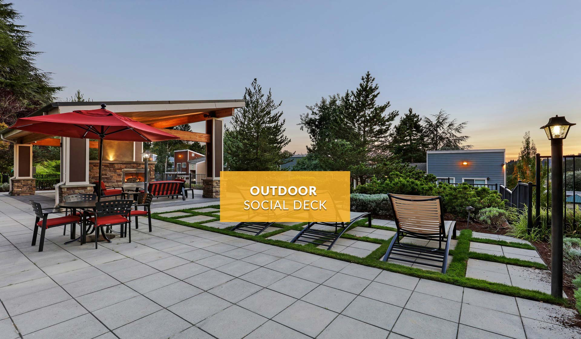 Cedar Rim Apartments - modern outdoor patio space with tables and chairs - newcastle, washington
